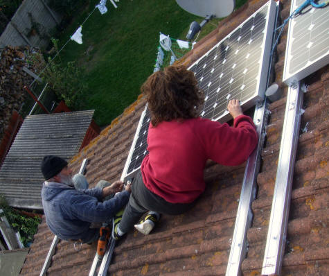 Rosie and Chris fitting the solar PV panels