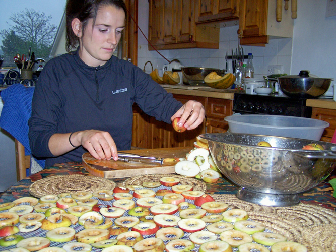 Charlotte our WWOOFer making apple rings for drying