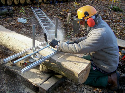 Chris using our chainsaw mill